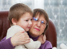 Grandson with grandmother Royalty Free Stock Images