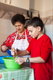 Grandson and grandmother making cookies Royalty Free Stock Photography