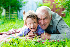 Grandson with grandparents Stock Images