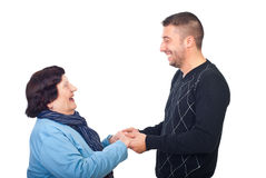 Grandson having conversation with grandma. Holding  her hands and laughing together isolated on white background,check also Grandmother Royalty Free Stock Photography