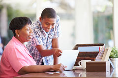 Grandson Helping Grandmother With Laptop Royalty Free Stock Images