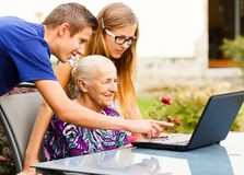 Grandson Helping Grandmother with Modern Technology stock images