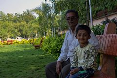 Grandson with his grandfather spending happy quality time in park royalty free stock photos