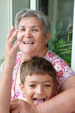 Grandson and his grandmother having fun together. Stock Photo