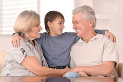 Grandson with his grandparents Stock Images