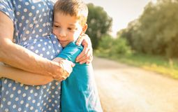 Grandson hugging to his grandmother outdoors Stock Images