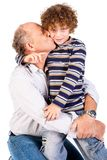 Grandson kissing his grandfather Royalty Free Stock Image