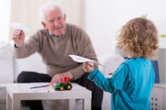 Grandson and paper airplanes Stock Photography