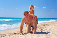 Grandson riding on grandpa's back, summer vacation Royalty Free Stock Photos