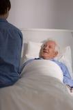 Grandson's visit at hospital. Aged sick men and his grandson's visit at hospital Royalty Free Stock Image