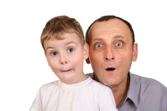 Grandson surprise. Grandson with grandfather surprise on white Royalty Free Stock Images