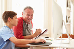 Grandson Teaching Grandfather To Use Computer Royalty Free Stock Image