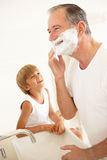 Grandson Watching Grandfather Shaving In Bathroom. Mirror Royalty Free Stock Photos