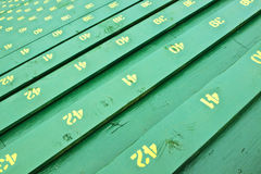 Grandstand Bench Seating. These grandstand stadium bench seats are numbered to find your seat quickly Stock Image