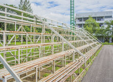 Grandstand Seats outdoor. On green grass field Royalty Free Stock Image