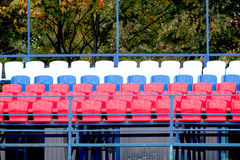 Grandstand stadium with many color seats Stock Photo