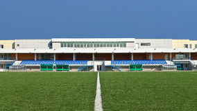 Sports field. Empty sports field with the white line markings and grandstand stadium stock photo