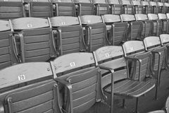 Grandstand Vintage Seats. These grandstand stadium seats have been used and painted over for many years Royalty Free Stock Photos