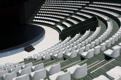 The grandstands of a modern summer outdoor amphitheater and a stage for small entertainment events Royalty Free Stock Photo