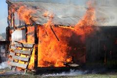 Graneros en el fuego Imagen de archivo libre de regalías