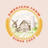 Grange américaine de ferme pour l'agriculture avec le moulin à vent, logo Photo libre de droits