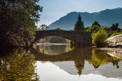 Grange Bridge reflected. Grange Bridge at the village of Grange over the River Derwent in the Lake District Royalty Free Stock Images