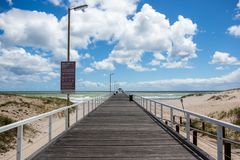 The grange jetty with a blue sky and white fluffy clouds at Gran. Ge South Australia on 7th November 2018 royalty free stock photography