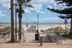 The grange jetty with a blue sky and white fluffy clouds looking. From the esplande at Grange South Australia on 7th November 2018 royalty free stock images