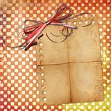 Grange sheet for design with red bow Royalty Free Stock Photography