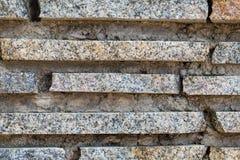 Granitów lampasy i betonowej ściany tło, tekstura obraz royalty free