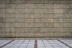 Granit deckt Wand- und Betonblockpflasterung mit Ziegeln Lizenzfreies Stockbild
