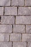 Granit gepflasterte Bürgersteigsstraße Hintergrund, Vignette Lizenzfreies Stockbild