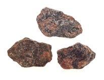 Granit på vit bakgrund Arkivfoto