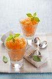 Granita. Fresh apricot granita in glass close up Stock Image