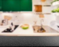 Granitcountertop med kökbakgrund royaltyfria foton