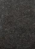 Granite. Dark textured granite stone fills frame Royalty Free Stock Image