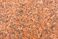 Granite. Red detailed smooth granite background Royalty Free Stock Photography