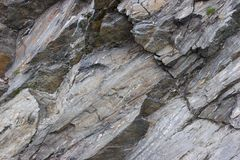 Granite. Detail of unfinished granite mountain grey rock stock photo