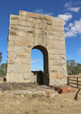 The granite arch is all that remains of the Grand Duke mine at Timor, which operated for 27 years and yielded 6125 kgs of gold Royalty Free Stock Images