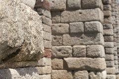Granite ashlar of Merida Aqueduct. Roman Aqueduct of Merida Los Milagros. Extremadura, Spain. East side Stock Image