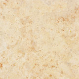 Granite background. Beige granite with natural pattern royalty free stock photos