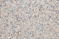 Granite background speckled with beige and black Royalty Free Stock Photos