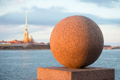 Granite ball close up in the light of the setting spring sun. Vasilievsky island, Saint Petersburg Royalty Free Stock Photography