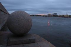 Granite ball. On the evening embankment stock photos