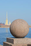 Granite ball on the spit of Vasilievsky island in the background of the Peter and Paul Cathedral. Saint Petersburg Stock Images