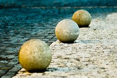 Granite balls. Near paved road Royalty Free Stock Photography