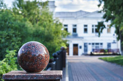 Granite balls at the city fence. Selective focus. Stock Photos