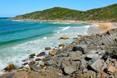 Granite Bay in Noosa National Park in Queensland, Australia. Rocky coastline and beach at Granite Bay in Noosa National Park in Queensland, Australia stock image