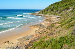 Granite Bay in Noosa National Park in Queensland, Australia. Rocky coastline and beach at Granite Bay in Noosa National Park in Queensland, Australia royalty free stock image