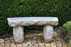Granite bench. In front of the green bushes Stock Image